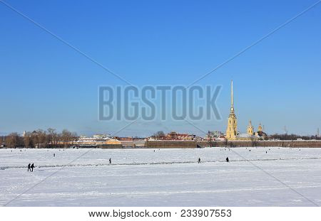 St. Petersburg City Winter Scene With Peter And Paul Fortress Architecture And People Walking On Fro
