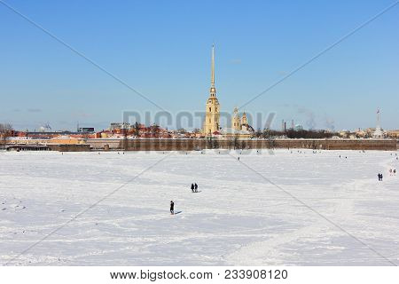 Peter And Paul Fortress View Across Frozen Neva River On Winter In St. Petersburg, Russia. Cityscape