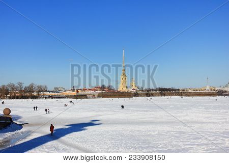 People Walking On Ice Of Neva River In Downtown Saint-petersburg, Russia. Winter Scene Cityscape Vie