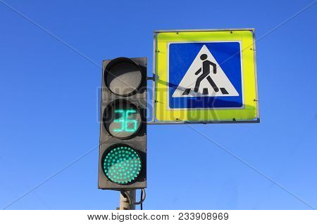 Green Traffic Light With Timer And Pedestrian Crosswalk Stop Signal On Blue Sky Empty Background. Ci