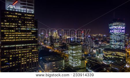 Night Panorama Of Warsaw From Above, Spire Tower And Downtown, Photo From The Drone, November 2016,