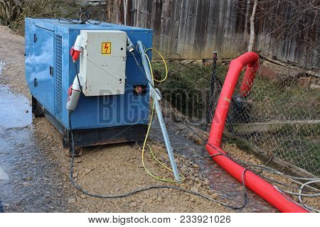 Enclosed Industrial Power Generator Providing Electrical Power To Large Water Pumps With Strong Red