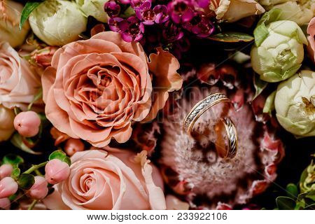 Wedding Bouquet And Rings. Close Up