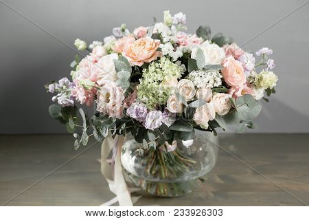 Beautiful Bouquet Of Flowers Set On Wooden Table. The Work Of The Florist At A Flower Shop.