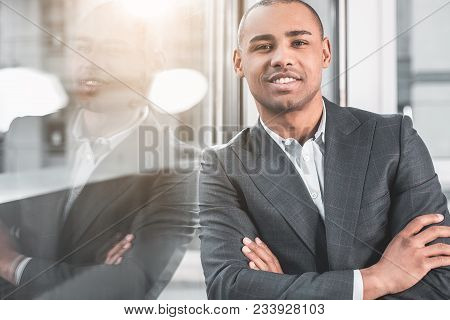 Close Up Of Waist Up Portrait Of Respectable Man Standing Near Window And Touching Shoulder To The G