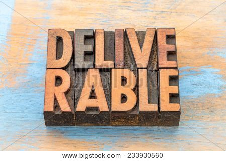 deliverable  - word abstract in vintage letterpress wood type
