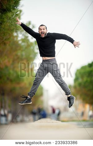 Jump... Excited Happy Man Jumping Up High, Wearing Casual Clothes