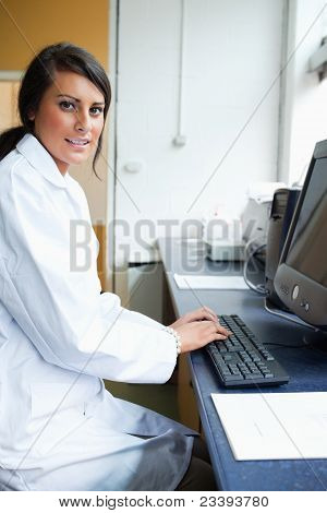 Portrait Of A Female Scientist With A Monitor