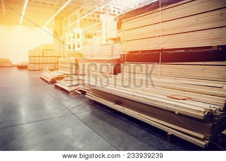Sawn Wood. Shelf With Structural Materials On The Shelves In The Construction Warehouse. High Contra