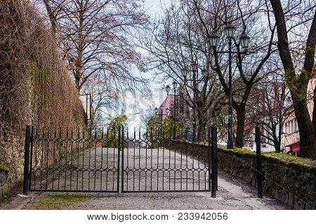Metal Gates On The Street Of Old Town. Lovely Scenery With Lanterns. Location Zhupanatska Street, Uz