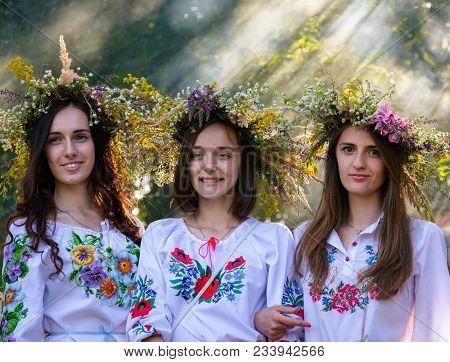 Uzhgorod, Ukraine - 07 Jul, 2016: Portraits Of Three Young Ladies With Traditional Wreath On Their H