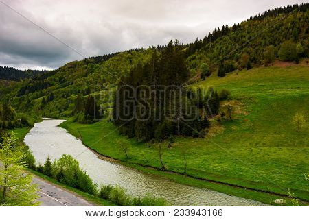River Near The Forest On Hillside On A Cloudy Day. Lovely Springtime Landscape In Mountains