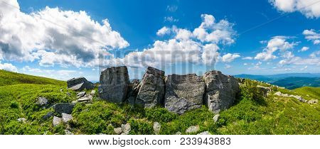 Mountainous Panorama With Boulders On Hillside. Beautiful Summer Landscape In Fine Weather Under The