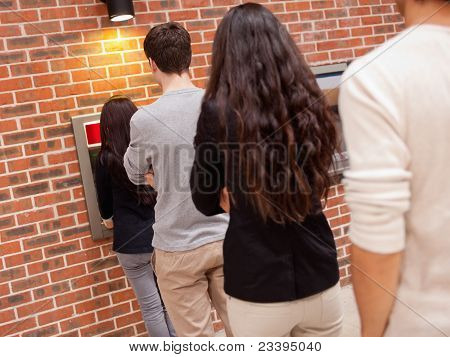People Queuing To Withdraw Cash
