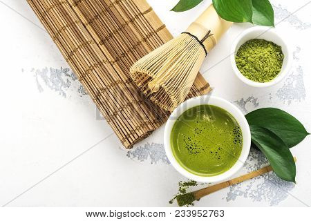 Green Matcha Tea Drink And Tea Accessories On White Background. Japanese Tea Ceremony Concept. Copy