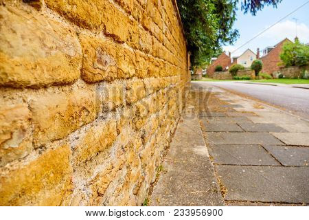 Old English Traditional Cottage Brick Wall Or Fence.
