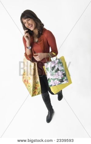 Woman With Shopping Bags And Cellular Phone