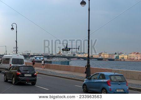 Russia, Saint Petersburg - August 18, 2017: City Traffic And Landing A Helicopter On A Floating Plat