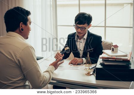 Business Lawyer Working About Legal Legislation In Courtroom To Help Their Customer