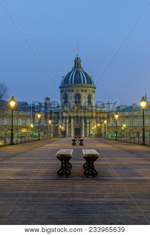 River Seine with Pont des Arts and Institut de France at night in Paris, France