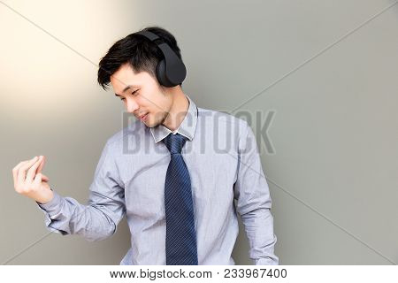 Handsome Business Man Is Snapping His Fingers While Listening His Favorite Music. Attractive Man Fee