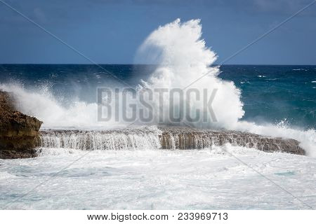 Giant Wave Breaking At Rocks At Porte D Enfer Du Moule, Guadeloupe (translation: Porte D Enfer Du Mo