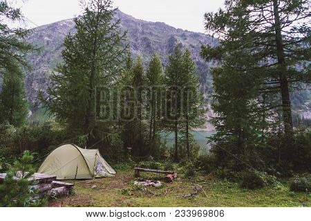 White Touristic Tent In A Forest