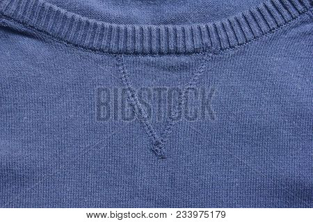 Navy Blue Knit Sweater V-neck Round Collar Close Up. Fashion Clothing Item Detail Of Crew-neck Sweat