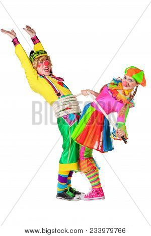 Two Smiling Clowns Is Playing A Rope Isolated Over A White Background