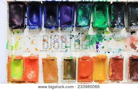 Paint Palette Close Up, Colorful Used Open Aquarelle Palette At Art Studio. Artist Work Place With M