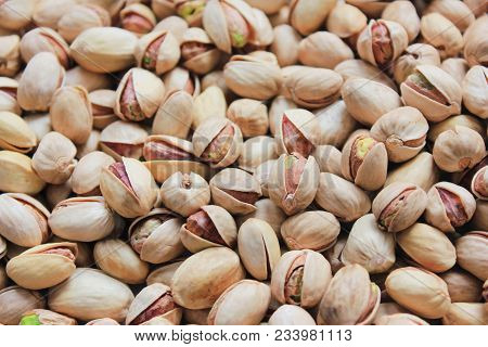 Pistachio Nuts Roasted And Salted In Shell Texture Background. Pile Of Fresh Green Tasty Pistachios