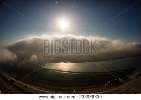 Beautiful Clouds Flying Over The Lake Near Mountains. Evening Time Shot Over The Clouds. Baku, Azerb