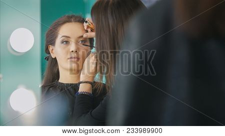 Makeup Artist, Hairdresser Working With Young Woman In The Beauty Salon, Shaping And Coloring Eyebro