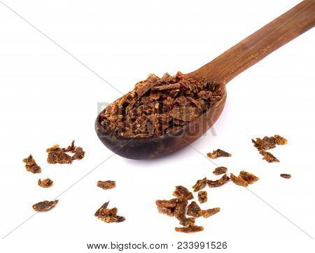 Propolis Granules In A Wooden Spoon. Bee Glue. Bee Products. Apitherapy