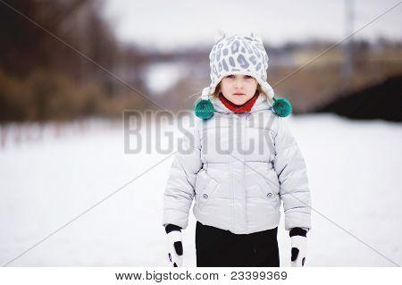 Outdoor Winter Portrait Of Cute Little Girl
