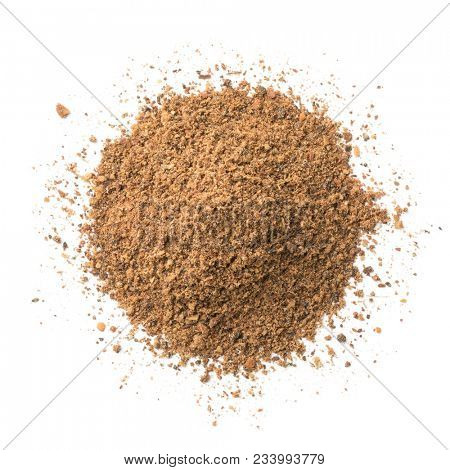 Heap of Moroccan Ras el Hanout powder isolated on white background