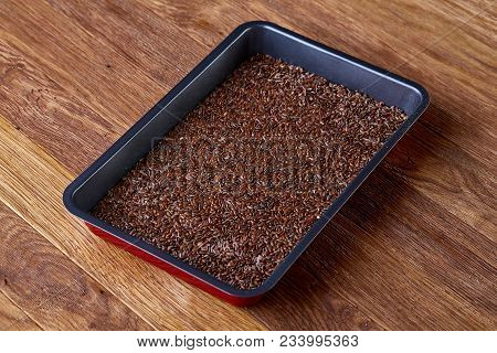 Nutritious flaxseed on baking tray over wooden background, selective focus, shallow depth of field. Nutritious and deitary ingredient. Natural organic condiment. Healing oilseed. Healthy lifestyle concept. poster