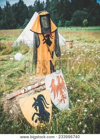 Red Black Knights Shields With Family Coat Of Arms And Scarecrow Of A Knight. Medieval Knight Attrib