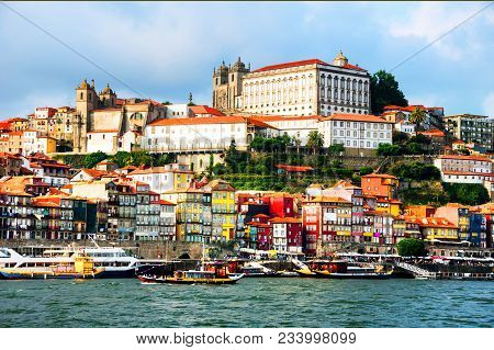 Porto, Portugal. Panoramic View Of Colorful Old Houses Of Porto, Portugal With Douro River. It Is A