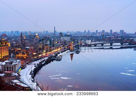Kyiv, Ukraine. Aerial View Of Podol And Dnipro River In The Evening In Kyiv, Ukraine. Modern Buildin