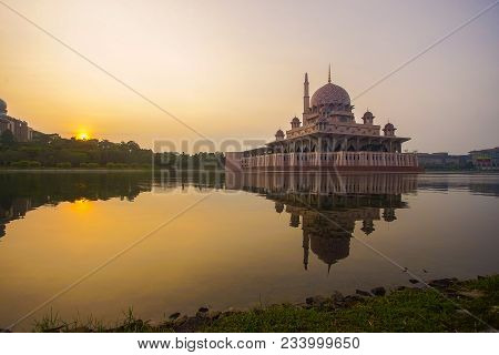 Mirror Reflection Of Beautiful Putra Mosque In The Lake During Sunrise.