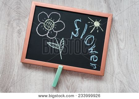 Still Life Of Children's Art With Chalk, Black Slate With Copper Frame With Painted Chalk Multicolor