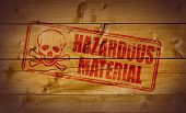 Hazardous Material stamp on wooden crate background poster