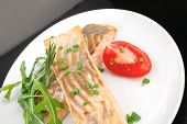 healthy sea food : roasted pink salmon fillet garnished with rocula, and tomatoes on white dish isolated over black background poster