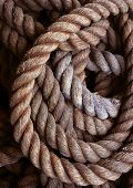 coiled textures of a mooring rope. poster