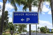 Sign indicating the location of a Driver Reviver site in Inglewood, Queensland, Australia. The site provides free tea, coffee and biscuits, toilet facilities, shade, seating and water. poster