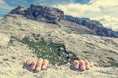 Closeup of fingers gripping a rock. Climbing outdoor. poster