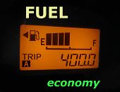 Fuel economy: fuel gauge and odometer showing a minimal fuel consumption poster