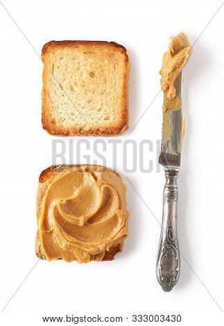 Toasted Bread With Peanut Butter And Knife Isolated On White Background, Top View