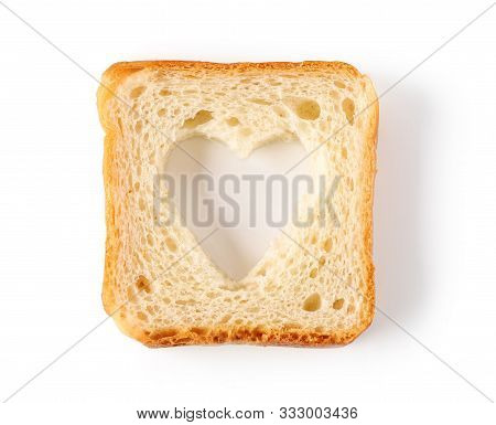 Bread Slice With Heart Shaped Hole Isolated On White Background, Top View